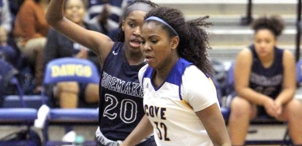 Cove sophomore Oni Boodoo drives the lane against Shoemaker's Zaiah Jackson during the Lady Dawgs' 47-44 loss to the Lady Wolves Tuesday at Bulldawg Gymnasium. Boodoo led the Lady Dawgs with 12 points and four assists.