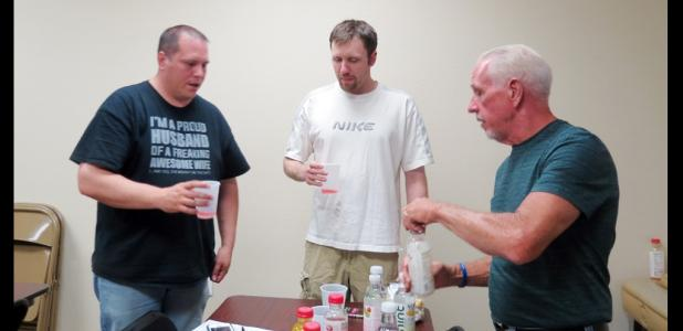 CCLP/DAVID J. HARDIN - Derek Chase, Matthew Shelley, and Stephen Bennett sample almonds and drink Bai antioxidant infusion drinks during the men's health improvement class last Thursday night at GymKix.