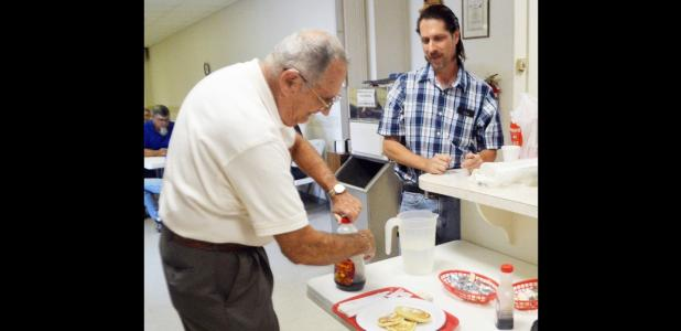 CCLP/LYNETTE SOWELL - John Moltz adds syrup to his pancakes during Saturday morning's all-you-can-eat pancake breakfast held by the Mt. Hiram Masonic Lodge. The event served as a fundraiser for the lodge's community service projects.