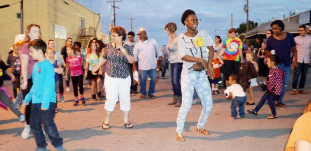 CCLP/LYNETTE SOWELL - Residents dance in the street during during Saturday night's National Night Out Kickoff Party held in downtown Copperas Cove. The two-hour event had games, activities, door prizes, and food. The event is held annually prior to National Night Out.