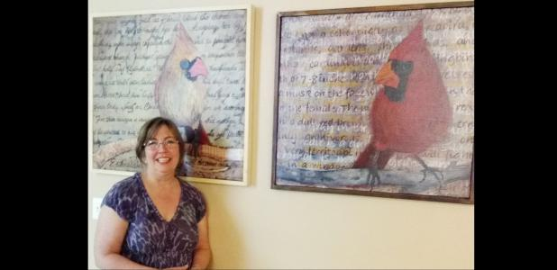 Courtesy photo - Linda Lapierre stands beside two of her paintings which were recently on display at the Copperas Cove Entrepreneur Center. Lapierre is showing her work at Frames & Things' monthly First Friday Art After Dark this Friday from 6-9 p.m.