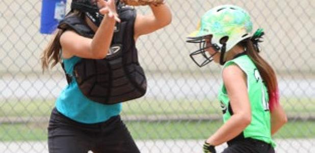 Cove Chaos' Hallie Kessinger scores as Rockdale Blasters catcher Payton Miller awaits the throw during their game Tuesday in the 2014 TTA Girls 12U State Tournament.