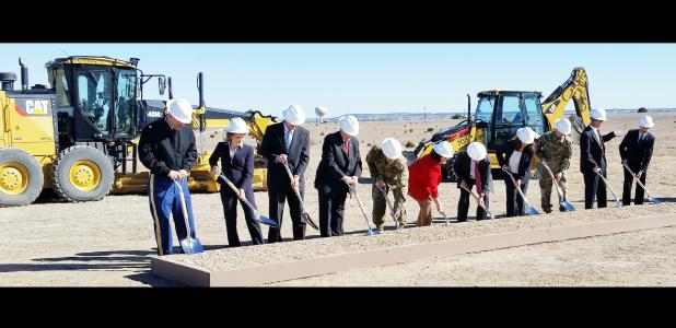 CCLP/CHUCK TAYLOR - Dignitaries turn the first shovels of dirt at a groundbreaking ceremony on Fort Hood Thursday afternoon.