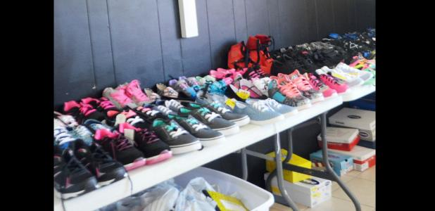CCLP/LYNETTE SOWELL - Rows of shoes are lined up inside the Mission Casa building on Casa Drive in preparation for the church's inaugural Shoozapalooza, to be held on August 6 from 11 a.m. until 3 p.m.