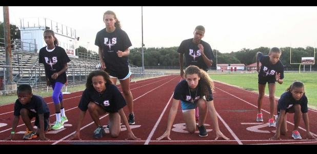 CCLP File Photo - The Centex Pacesetters pose for a picture during practice at Salado Junior High in preparation for this weekend's Texas Amateur Athletic Federation State Track and Field Meet in McAllen. The Pacesetters are, left-to-right (front row): Jaylen Watson, Zoe Pearson, Jorja Washington and Abigail Mouton. Back row: Michaela Mouton, Brianna Washington, Reginald Mouton and Katelyn Mouton. They are coached by head coach Vincent Watson and assistant coaches Derwin Graham and Anthony James.
