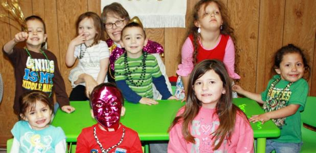 CCLP/KATHLEEN STARLING Reverend Paulette Magnuson with the smallest of her flock celebrate Shrove Tuesday with beads, masks and pancakes