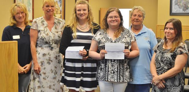 CCLP/LYNETTE SOWELL  Mikayla Miller and Delaney Brown receive $500 scholarship checks from Keep Copperas Cove Beautiful at Tuesday night's city council workshop.