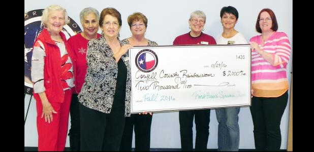 File Photo - Members of the Fort Hood Spouses Club present a check for $2,000 to the Coryell County Rainbow Room based in Copperas Cove. The facility provides clothing, shoes and more to children who have been removed from their home by Child Protective Services.