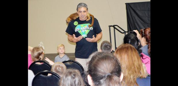 CCLP/BRITTANY FHOLER - Robert Trejo with Zoomagination talks about the kinkajou on his shoulders during Saturday's 7th annual Eco Harvest festival.
