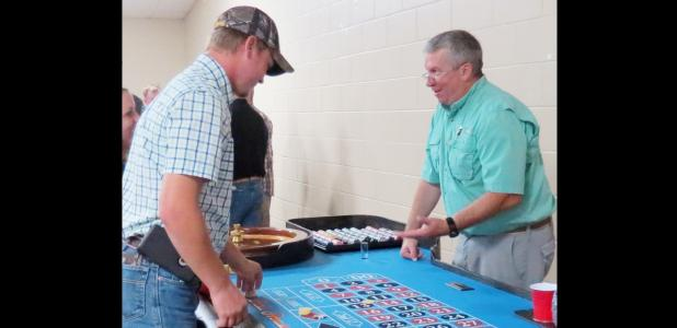 CCLP/BRITTANY FHLER - John Oster runs the roulette table at the Buyer's Club Casino Night held Saturday night at the Copperas Cove Civic Center.