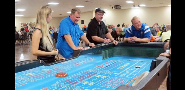 CCLP/BRITTANY FHOLER - People played Craps at the Inaugural Buyer's Club Casino Night held Saturday night at the Copperas Cove Civic Center.