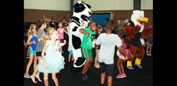 FILE PHOTO - Children and families gathered at a past National Dance Day to kick up their feet and learn some dance routines at GymKix.