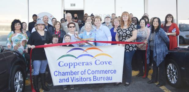 CCLP/LYNETTE SOWELL - Joann Courtland and Trudy Bolton with Operation Stand Down Central Texas cut the ribbon to the nonprofit's newer, larger location in Cove Terrace Shopping Center on Saturday.