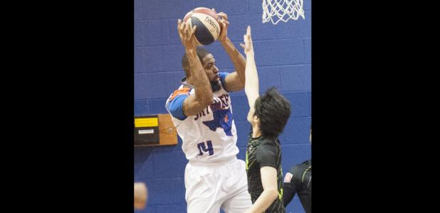 CCLP/DAVID MORRIS - Terence Dill of the Texas Sky Riders ABA basketball team hauls in a rebound against the Shizuoka Gymrats Friday at Camp Triumph in Copperas Cove.