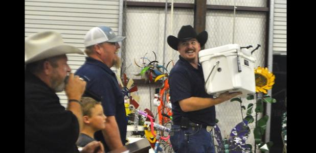 CCLP/LYNETTE SOWELL - A Yeti cooler was among the items auctioned off at Saturday night's all-you-can-eat fajita dinner and auction held at the Oakalla Volunteer Fire Department.