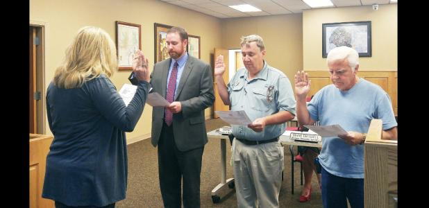 CCLP/LYNETTE SOWELL - Adam Martin, Christian Mulvey and Harald Weldon are sworn in by Bradi Diaz as the newest board members of the Copperas Cove Economic Development Corporation at the EDC's monthly meeting on Tuesday. The three newly appointed board members join Marc Payne and Annabelle Smith on the board.