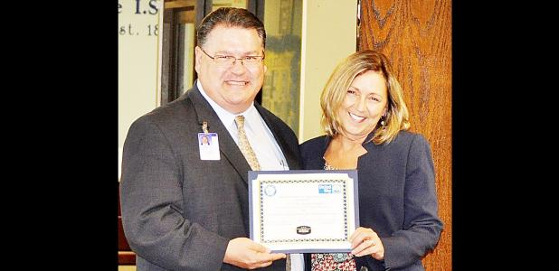 COURTESY PHOTO - S. C. Lee Junior High Principal Kayleen Love accepts the United Way Year-Over-Year Increase award on behalf of her campus representative Shannon Thompson. Under Thompson's leadership, the campus increased its fundraising total by more than 160 percent over 2015's total