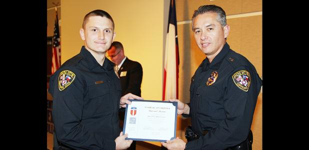 Courtesy Photo - Malcolm Deaton accepts congratulations from Copperas Cove Police Chief Eddie Wilson upon completing and graduating from the Basic Peace Officer course from the Central Texas College Police Academy on Saturday. Deaton and four of his fellow graduates were sworn in to the Copperas Cove Police Department yesterday morning.