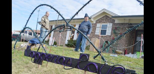 CCLP/LYNETTE SOWELL - Christian Mulvey plans out the light display with his son-in-law Dustin Phipps on Friday afternoon. Mulvey will have his 3rd annual light show set to music at 1605 Little Ave. 7-10 p.m. nightly from Dec. 15-31. Mulvey has a facebook page for his display facebook.com/lightsofchristmas