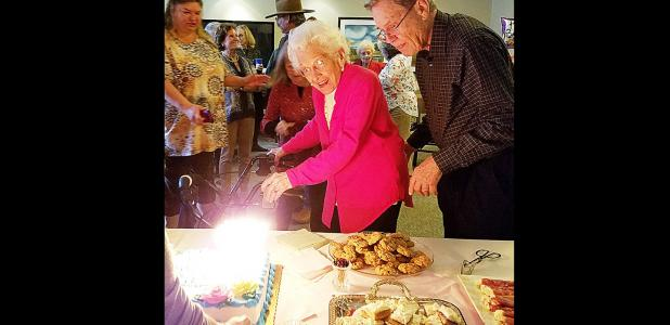 CCLP/PAMELA GRANT - Surrounded by friends and family, Cove's oldest living resident, Edna Teinert, pre-pares to blow out the candles on her 106th birthday cake.