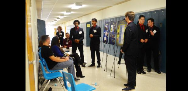 CCLP/LYNETTE SOWELL - A student team practices their presentation in a hallway at CCHS during the DECA Region V district conference held Saturday. Nearly 1,000 students came from 26 area high schools to compete for a shot to advance to the state competition in San Antonio.