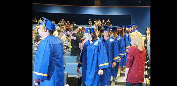 CCLP/DAVID J. HARDIN - Crossroads High School graduates walk into the Lea Ledger Auditorium during last Thursday's Fall 2016 commencement ceremony. 25 students re-ceived their diplomas.