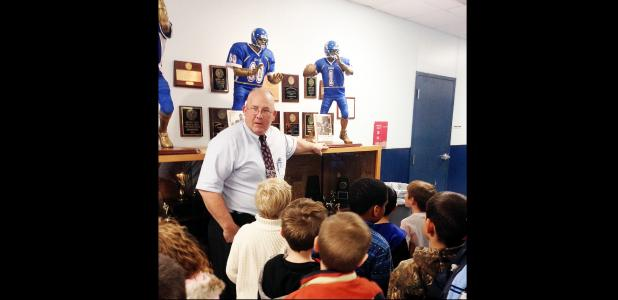 COURTESY PHOTO - CCISD Athletic Director Jack Welch greets second grade gifted education students and takes them through the hall of fame in the athletic annex. Students were visiting with athletic trainers to learn about the importance of movement to their overall health.