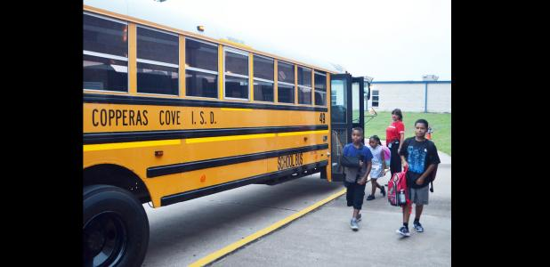 CCLP/TRAVIS MARTIN - Students return by the bus load to Clements Parsons Elementary School for the start of a new year.