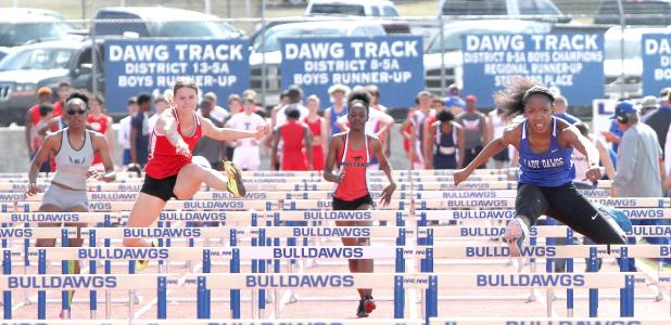 CCLP/TJ MAXWELL - Cove sophomore Mahal Thorpe leads her heat of the 100-meter hurdles during the the Bulldawg Relays held Saturday at Bulldawg Stadium. Thorpe finished second overall with a time of 15.86 seconds.