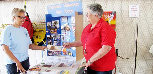 CCLP/PAMELA GRANT - Nancy Owen hands out a fire safety pamphlet during the Kempner Volunteer Fire Department's open house.