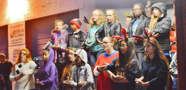 "CCLP/LYNETTE SOWELL - The Copperas Cove Junior High School choir sings ""Silent Night"" in several languages and performs it using sign langugage on Friday night at Krist Kindl Markt in downtown Copperas Cove."
