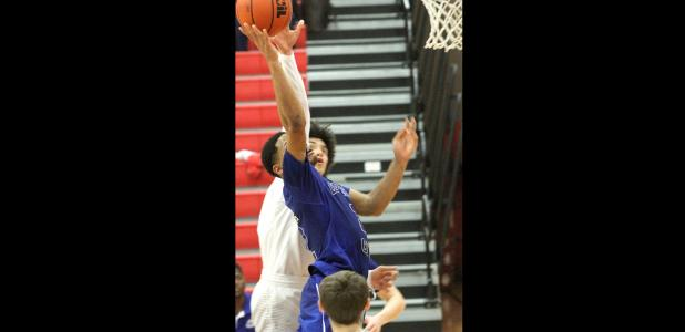 CCLP/TJ MAXWELL - Copperas Cove senior Dahmir Pearson scores on an 'and 1' opportunity to give the Bulldawgs a 44- 43 lead in the fourth quarter of their 49-43 win over Belton Friday in Belton. Cove outscored Belton 25-6 over the final 9:46 of game action to secure the win.