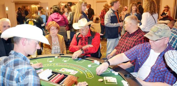 CCLP/TRAVIS MARTIN - Blackjack tables were full at the Annual Wild West Night hosted by the Fort Hood Spouses' Club on Friday night at Club Hood. The annual fundraising event held live and silent auctions to help bring in proceeds to help the local communities through scholarships and grants.