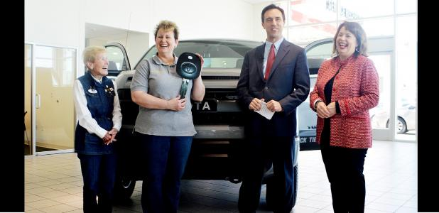 CCLP/LYNETTE SOWELL - Joann Courtland, director of Operation Stand Down Central Texas, is all smiles on Friday afternoon after receiving the keys to a 2017 Toyota Tundra at Toyota of Killeen. OSDCT was selected by Congressman Roger Williams' (R-Austin) office to receive the one-of-a-kind Black Tie & Boots Edition Tundra from Gulf Coast Toyota.