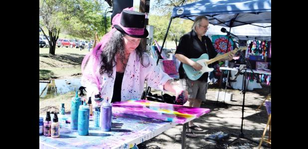 "CCLP/LYNETTE SOWELL - Sheryll ""Razzy"" Schoolfield and Randel Renaud of New Braunfels, who make up the performance art duo of ""Razzy and Randel"" were among the more than 39 vendors at the 2nd annual Five Hills Art Festival held on Saturday at City Park."