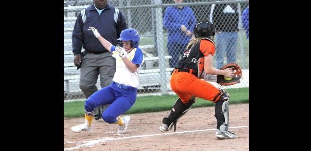 CCLP/TJ MAXWELL - Cove sophomore Addie Cook slides into home plate in front of the tag attempt by San Angelo Central catcher Mickayla Jones during the second inning of the Lady Dawg's 13-3 mercy-rule win over the Lady Bobcats Tuesday in Cove. Cook was 1 for 3 with a three RBI triple in the fifth inning.