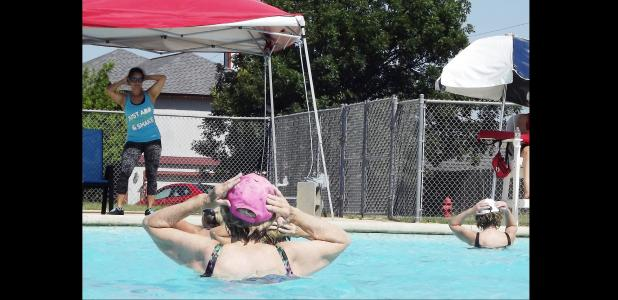 CCLP/PAMELA GRANT - Aqua Zumba Instructor Jeannette Valentine leads her class through a variety of aerobic exercises.