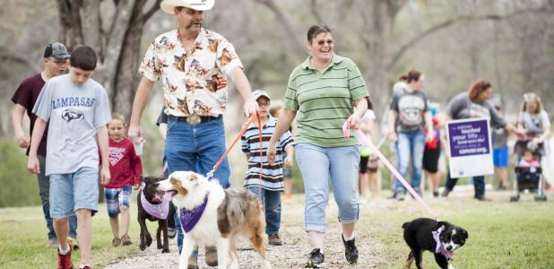 FILE PHOTO - Walkers make their way around the track of the sculpture garden during the inaugural Bark For Life, held in Lampasas. Area dogs and their owners can give the same support by attending Bark For Life in Lampasas on Saturday, an event held by Relay For Life Lampasas-Copperas Cove.