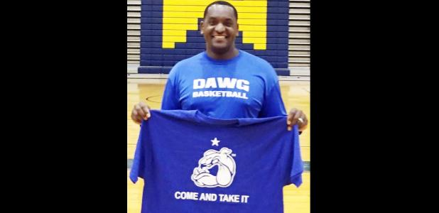 "Courtesy Photo - Copperas Cove High School basketball coach Billy White holds up one of the tshirts with the motto of his hometown of Gonzalez. The educator is using the slogan, ""Come and Take It"" to motivate his players while teaching them history and character education simultaneously."