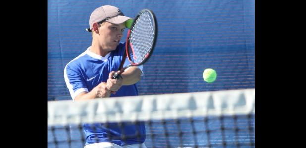 CCLP file photo - Cove senior Brett Alber hits a backhand during the team tennis playoffs in October. Alber and doubles teammate Nick Motley won a silver medal at the Rocket Invitational in Waco last Friday.