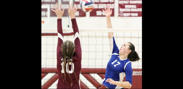 CCLP/ TJ MAXWELL - Copperas Cove senior Brianna Acker hit for a kill against Killeen's Rhepsey Wyman during the Lady Dawgs' 3-1 win (25-18, 25-23, 21-25, 25-11) over the Lady Roos on Tuesday in Killeen.
