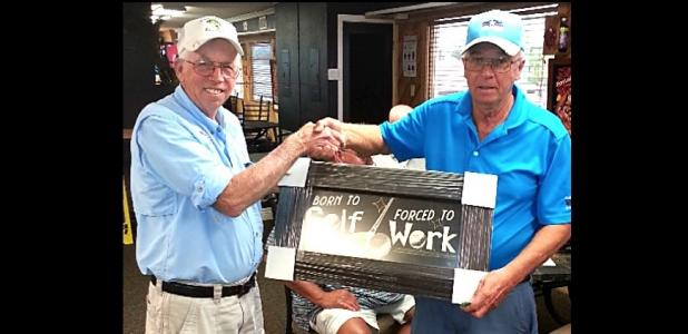 """CCLP/TJ MAXWELL - Buck Wilkins, right, is presented with the Ledger Furniture donated golf plaque """"Born to Golf/Forced to Work' by Cove Bass Club secretary Jack Johnson"""