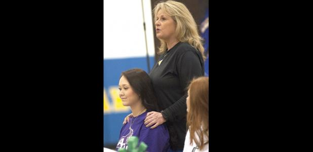 CCLP/DAVID MORRIS - Copperas Cove head coach Cari Lowery talks about the career of Brianna Acker, left, during National Signing Day festivities Wednesday in the high school gym.