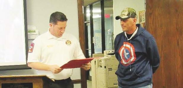 CCLP/BRITTANY FHOLER - Copperas Cove Fire Department Chief Michael Neujahr recognized CCISD Maintenance Department employee Raymond Riddle, at Tuesday's Board of Trustees meeting, for his efforts in extinguishing a fire in the yard of a residence on the bus route last Thursday.