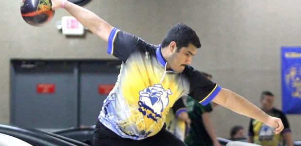 CCLP/TJ MAXWELL - Cove's Chris Ochoa pulls back for his shot during the Central Texas District finale Tuesday at Hallmark Lanes in Killeen. Ochoa and the rest of the coed squad qualified for regionals.