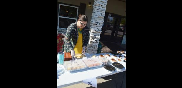 CCLP/LYNETTE SOWELL - Christy Kirkpatrick slices homemade cheesecake at Copperas Cove Nursing & Rehab's bake sale on National Pi Day. The bake sale was held as a fundraiser for the National Alzheimer's Association.