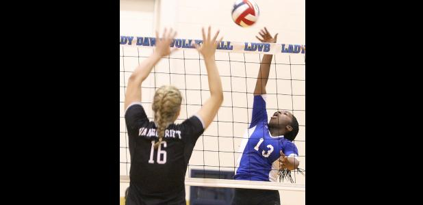 CCLP/TJ MAXWELL - Copperas Cove senior Chyanne Chapman hits against Vandegrift senior Effie Zielinski during their match on Tuesday. The Lady Dawgs are 2-2 on the season after the first two contests of the Austin Varsity tournament.