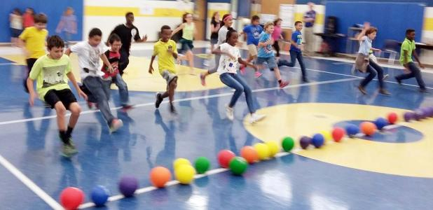 Courtesy Photo/CCISD - Clements/Parsons Elementary students rush to the center court line to grab a ball and attempt to knock out a school administrator in a friendly game of dodge ball. The school offered the opportunity to all students who had perfect attendance for the first six weeks.