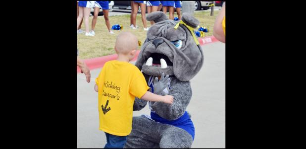 Connor Hedge meets the Copperas Cove Bulldawg Mascot at the send-off rally for him on Monday