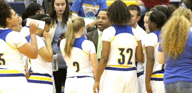 CCLP/TJ MAXWELL - Cove head coach Eldridge McAdams talks to his team in a time out during the Lady Dawgs' 49-25 win over the Harker Heights Lady Knights.